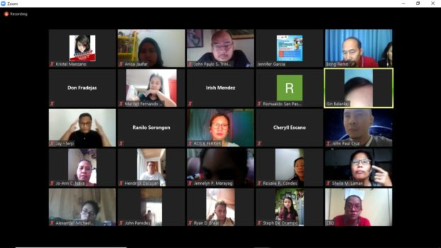 A screenshot of a computer with faces of participants of a zoom meeting in boxes